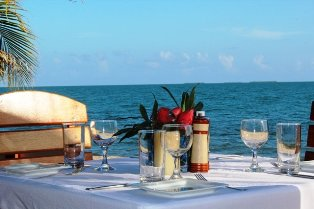 Dining at Cafe Mar Beach-side table Belize Resort Chabil Mar
