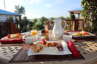 Dining on Veranda 16 Breakfast Chabil Mar Belize Resort